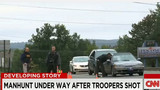 Manhunt Underway After Troopers Shot
