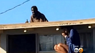Woman Hides From Intruder On Roof