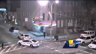 Video Shows Baltimore Officer Hitting Man