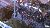 Ferguson Protesters Flip Police Car Outside City Hall