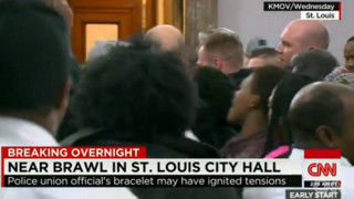Cops, Citizens Scuffle at St. Louis Meeting