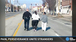 Ky. Officer Helps Woman Finish Race