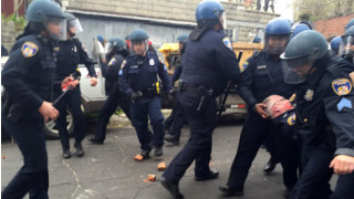 Baltimore Police Officers Injured in Violent Riots