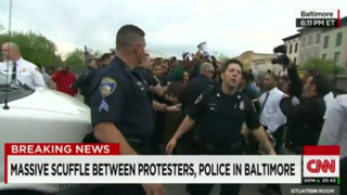 Baltimore Police Officers, Protesters Clash