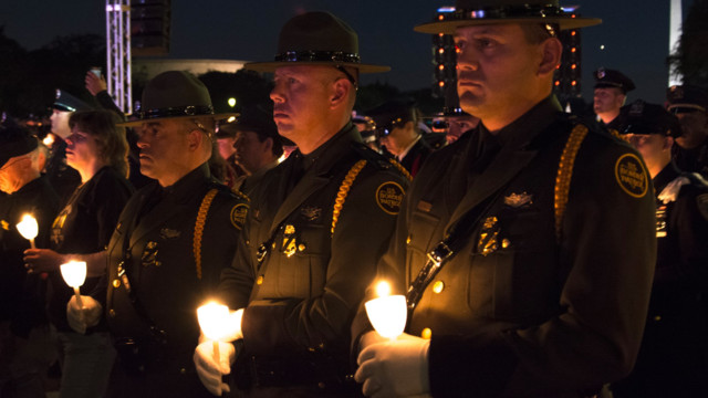 Hundreds honor fallen HPD officers at candlelight vigil after police march