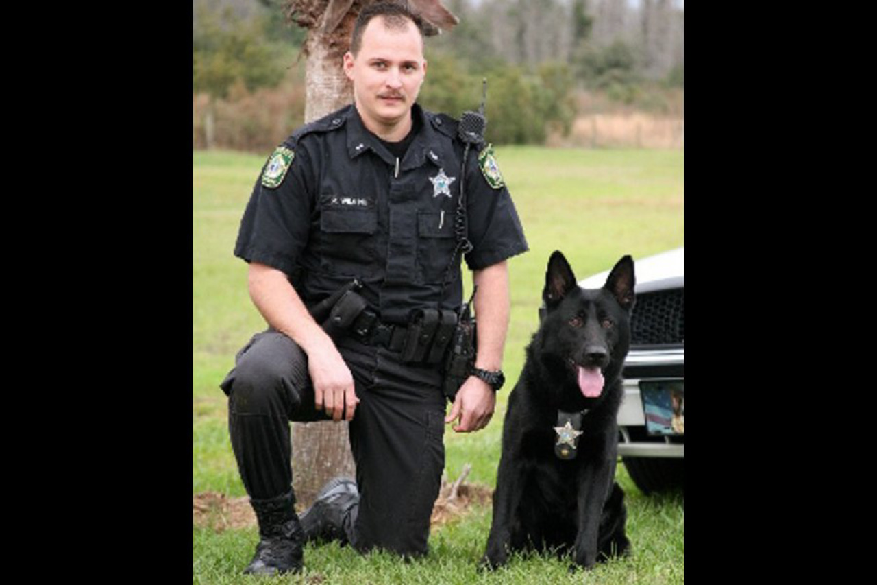 K-9's Death Leaves Pasco County, Fla  Deputy Robert Wilkins With