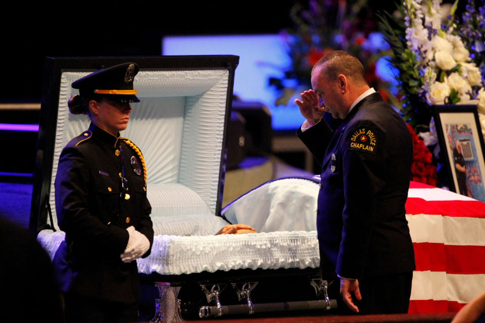 funeral services begin for fallen dallas police officers