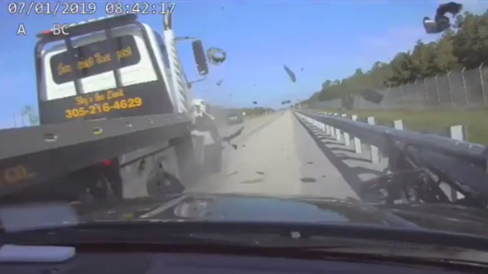 Dashboard Camera Video Shows Tow Truck Slam Into Side of