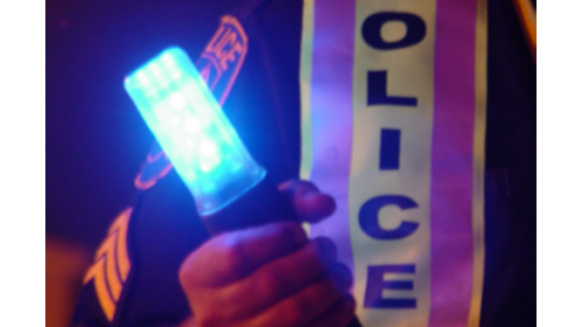 blue ice in police hand close up.tif