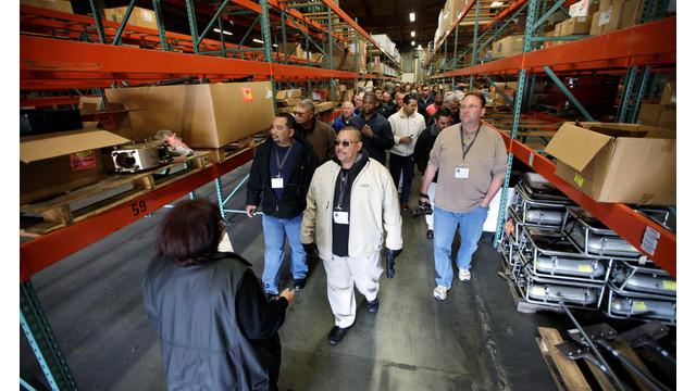 law enforcement officers look at a warehouse of military surplus.jpg_10726994.jpg