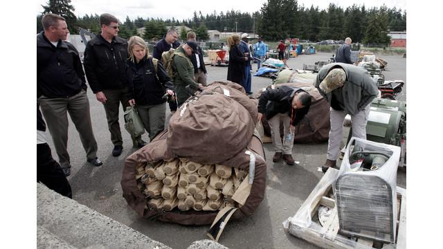 Officers Examine Surplus Materials.jpg_10726993.jpg