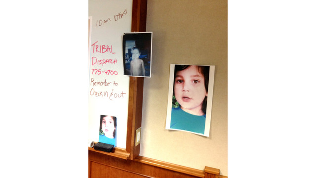 A Photo of a Missing Michigan Boy Is Posted at a Command Post.jpg_10736049.jpg