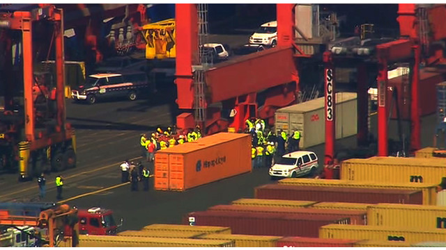 Responders Surround Shipping Containers that May Hold Stowaways.jpg_10735479.jpg