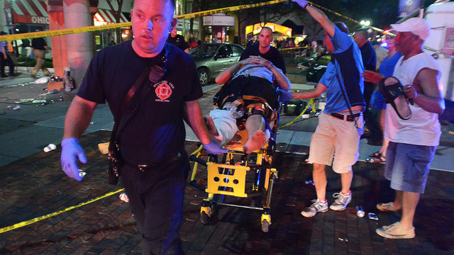 Rescuers Move a Patient After a Car Crashes Into Crowd in Ohio.jpg_10730645.jpg