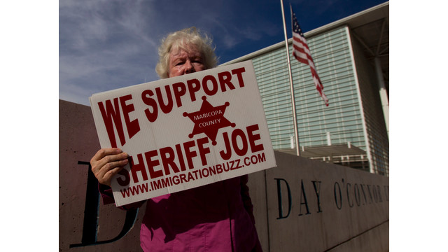 Sheriff Joe Supporter Holds Sign in Arizona.jpg_10747594.jpg