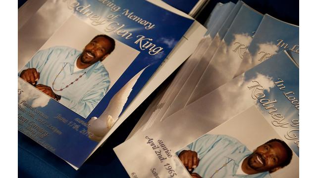 Stacks of Programs at Rodney Kings Funeral.jpg_10736779.jpg