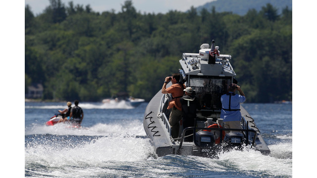 Security Personnel Follow Mitt Romney and Wife, Ann, on Jet Ski in NH.jpg_10737705.jpg