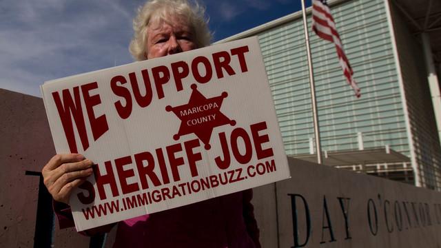 Sheriff Joe Supporter Holds Sign in Arizona.jpg_10747594.jpg
