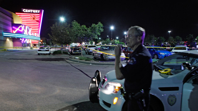 Officer stages in front of Aurora Colo. Theater shooting.jpg_10748778.jpg