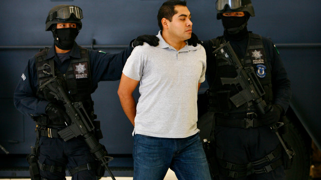Suspect in Mexico Police Shooting Escorted.jpg_10742758.jpg
