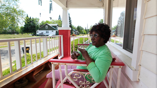 Detroit Woman Sits on Her Porch in Nearly Empty Neighborhood .jpg_10754891.jpg