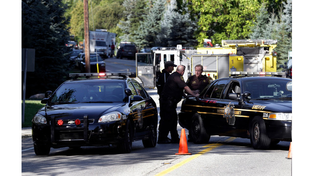 Police block traffic in West Bloomfield, Mich. were an office Was killed.jpg_10777317.jpg