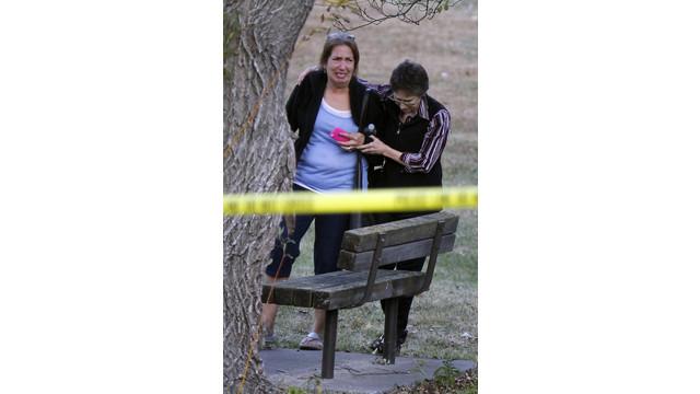 Woman consoled at shooting scene.jpg_10795934.jpg