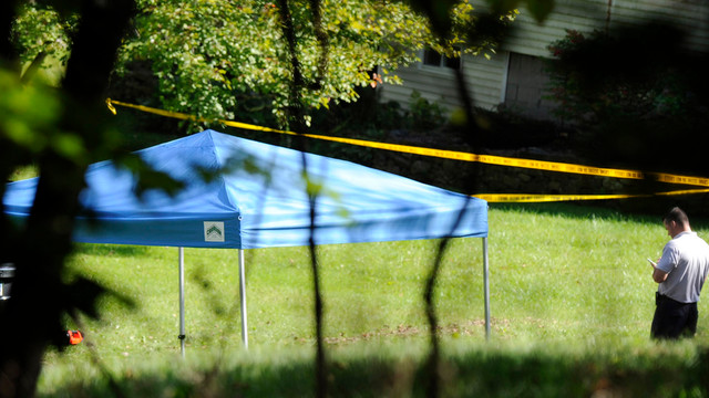 A blue tent protects the scene of a fatal shooting .jpg_10795941.jpg