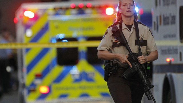 An officer secures the area as police investigate a shooting.jpg_10795936.jpg