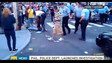 Philadelphia Police Officer Punches Woman in Her Face on Busy Street