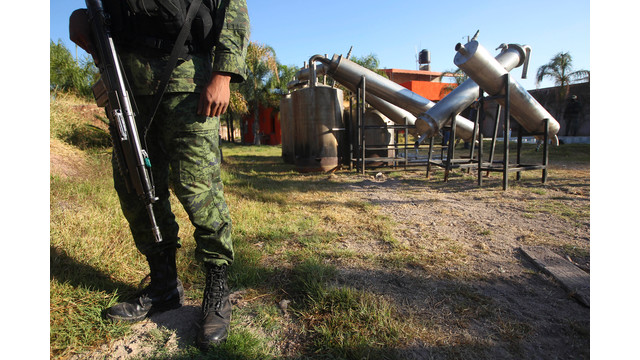a soldier stands in what was identified as metal reactors .jpg_10813524.jpg