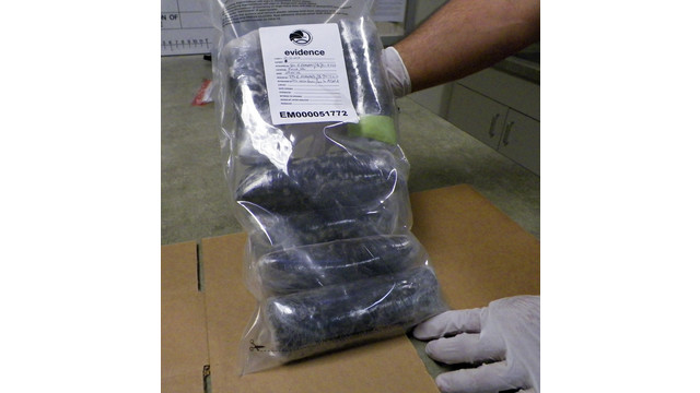 Drug Enforcement Administration technician holds several pounds of Mexican meth.jpg_10813521.jpg