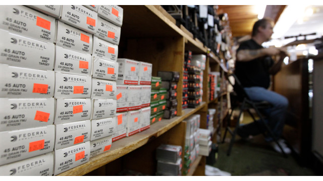 boxes of ammunition line the shelves of a gun shop in Tinley Park, Ill..jpg_10815968.jpg
