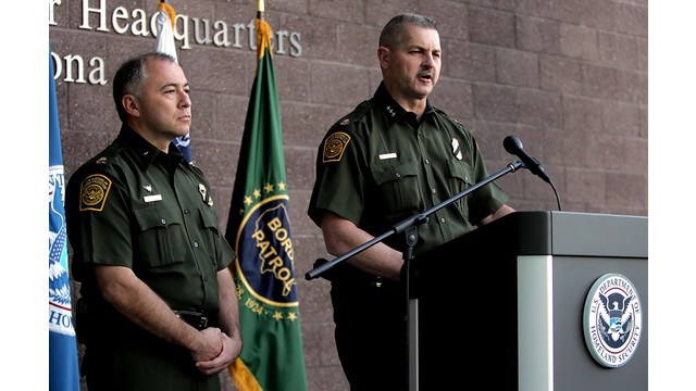 Cmdr. Jeffrey Self, of U.S. Customs and Border Protection, flanked to his left by Acting Chief Patrol Agent Manuel Padilla..jpg_10809493.jpg
