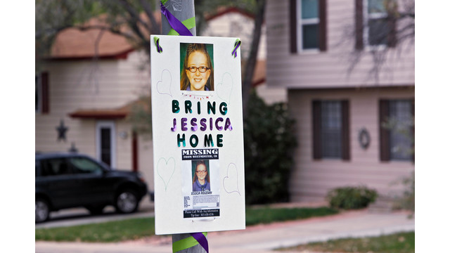 A missing person sign is posted on a lamp post.jpg_10812765.jpg