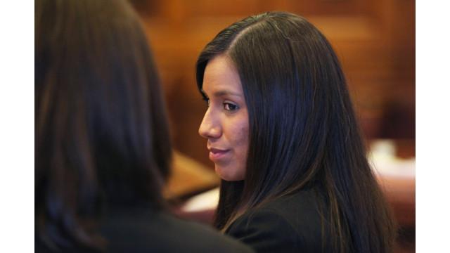 Alexis Wright, 29, turns towards her attorney Sarah Churchill.jpg_10815304.jpg
