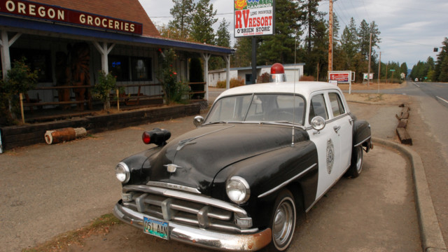 An old police car is permanently parked on the highway through O'Brien, Ore..jpg_10815313.jpg