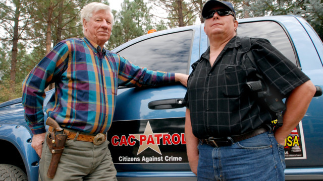 Sam Nichols, left, and Glenn Woodbury pose in front of Woodbury's pickup in O'Brien, Ore..jpg_10815310.jpg