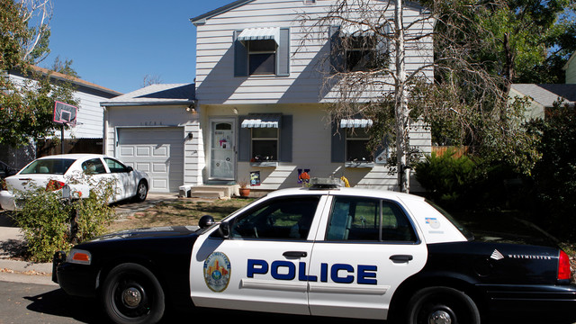 A Westminster police officer sits in her partrol car at the home of ten-year-old Jessica Ridgeway.jpg_10811211.jpg