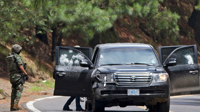 In this Aug. 24, 2012. file photo, an armored U.S. embassy vehicle is checked by military personal.jpg_10797748.jpg