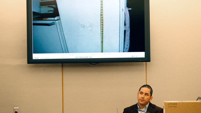 Dallas police officer Abel Lopez listens to a question.jpg_10812854.jpg