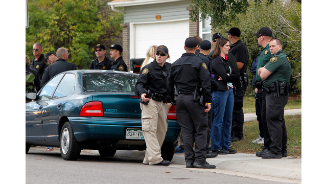 Police gather after canvassing a neighborhood.jpg_10812767.jpg