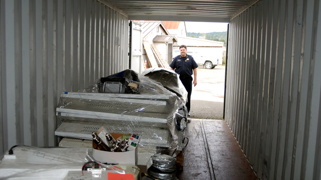 Chief Tom Chapman standing with a shipping container.jpg_10824386.jpg