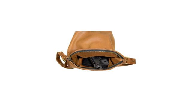 bag-packer-in-handbag_11079836.jpg