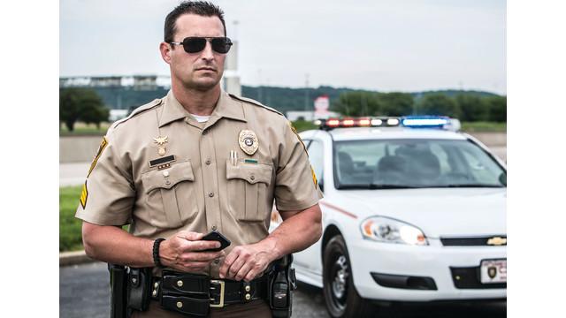 Officer-car-phone.jpg